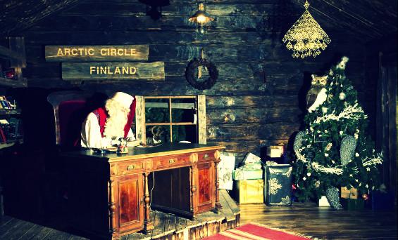 Santa Claus sits at his desk in his offi
