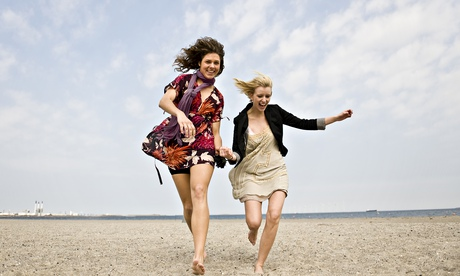 Two women running on the beach, Amager Strandpark, Copenhagen, Denmark